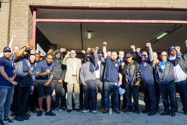 two men and a truck workers rally for union